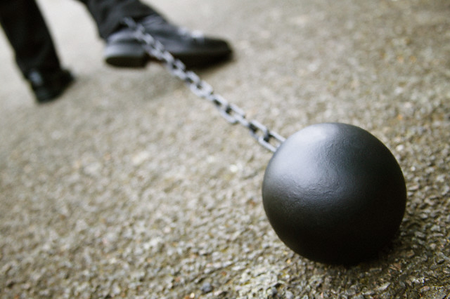 Businessman Dragging a Ball and Chain